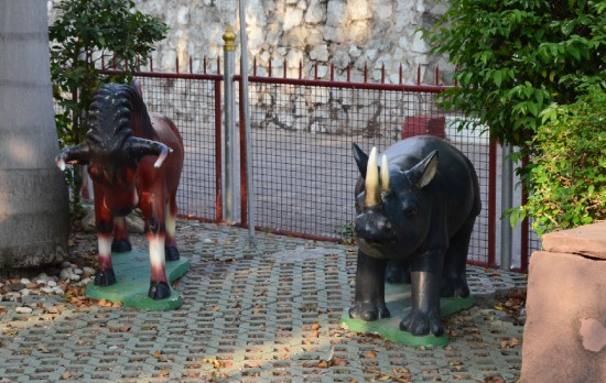 Stone rhino in a Buddhist temple garden in Chomburi (Thailand)